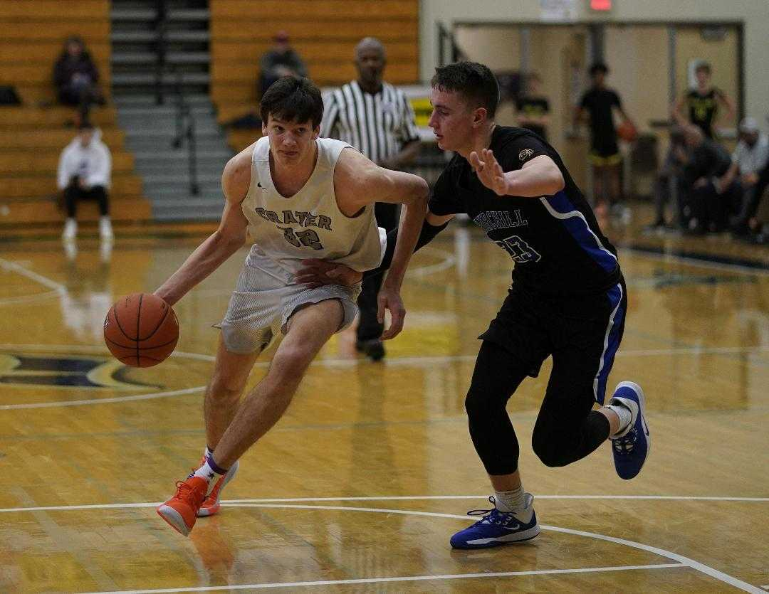 Crater's Nate Bittle drives around Churchill's Brian Goracke on Monday at the Les Schwab Invitational. (Photo by Jon Olson)