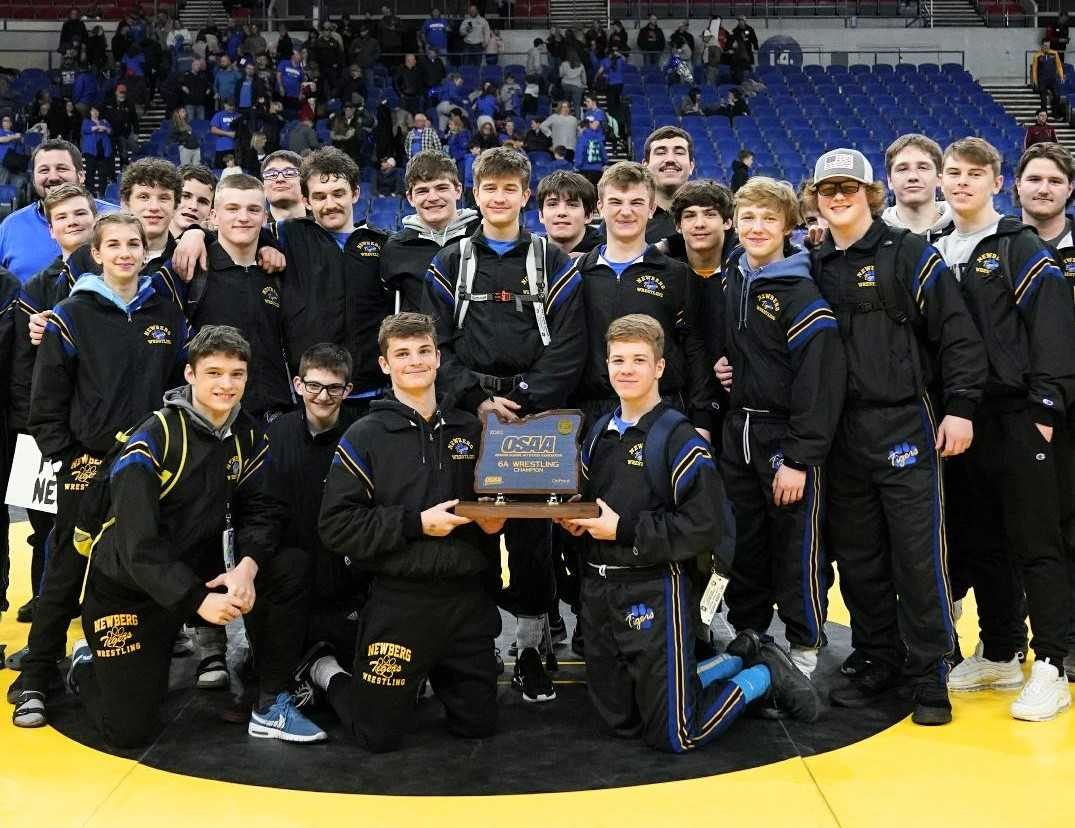 Newberg wrestlers pose with their first championship trophy since 2009. (Photo by Jon Olson)