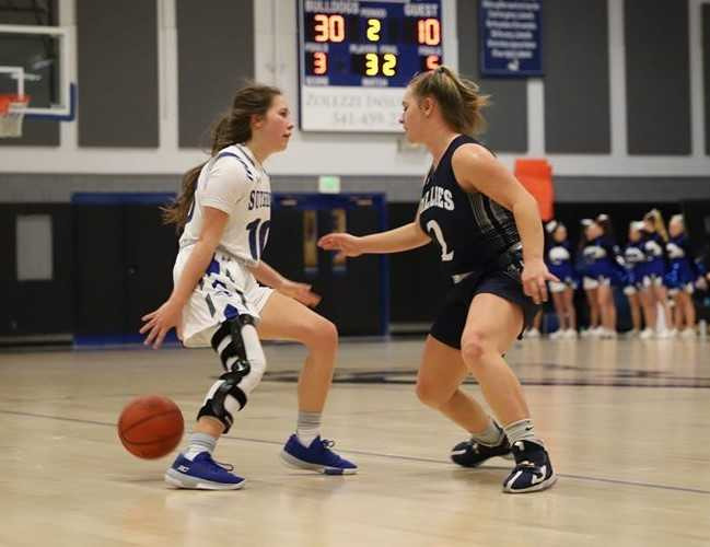 Sutherlin's Kiersten Haines (left) made 11 three-pointers in one game this season. (Photo by DelRae Bodine)