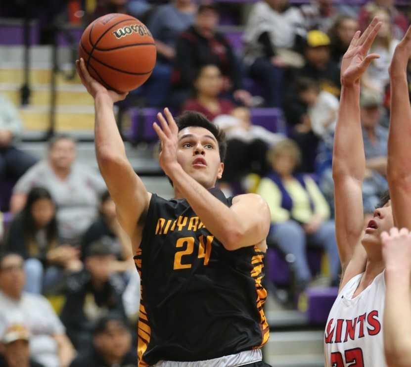 Nixyaawii senior Mick Schimmel scored a team-high 25 points against Trinity Lutheran. (NW Sports Photography)