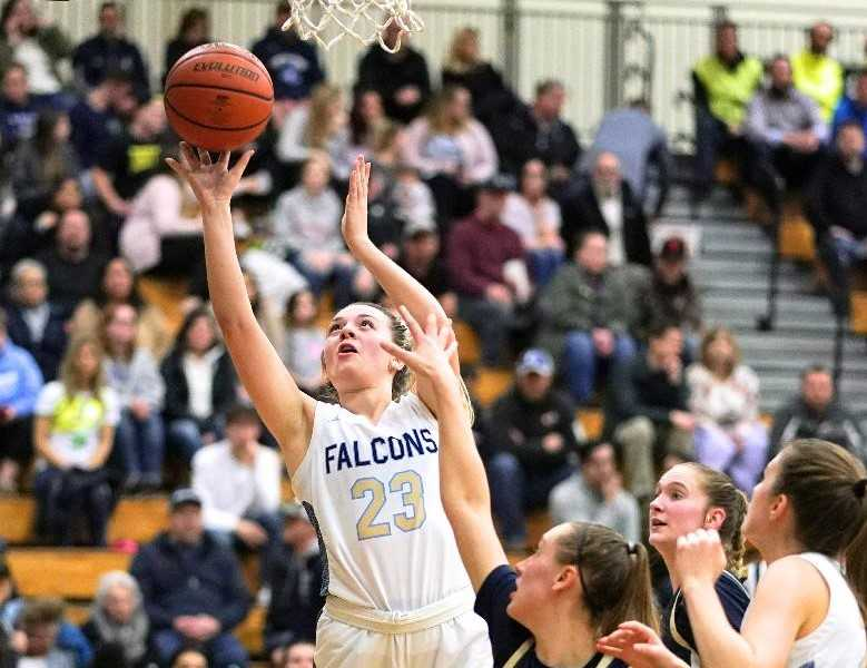 Liberty's Bella Hamel goes up for two of her team-high 13 points against Canby on Friday. (Photo by Jon Olson)