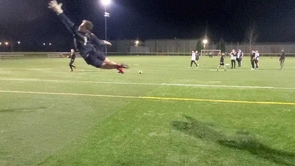 Summer looks like Gabe Giancarlo flying through the air for a soccer save