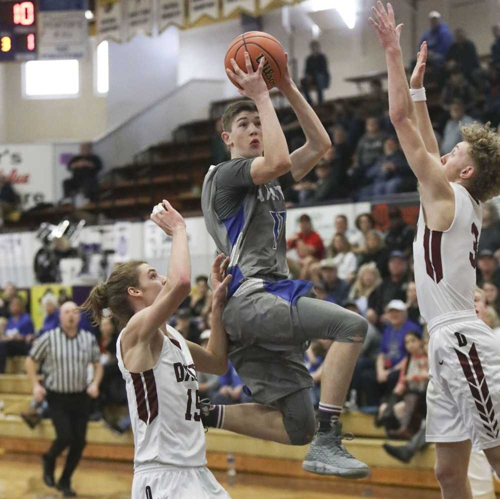 Keenan Graham splits the defense to score in the 2019 3A state tournament. Photo courtesy of The World Newspaper/Amanda Loman
