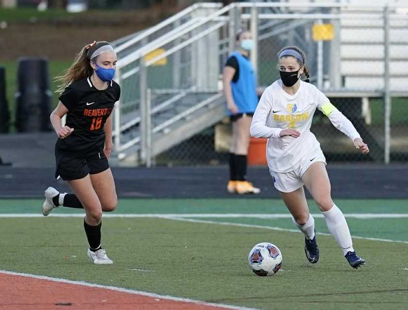 Barlow's Mikayla Topaum (right), working against Beaverton's Katelyn Sanders, scored twice Monday. (Photo by Jon Olson)