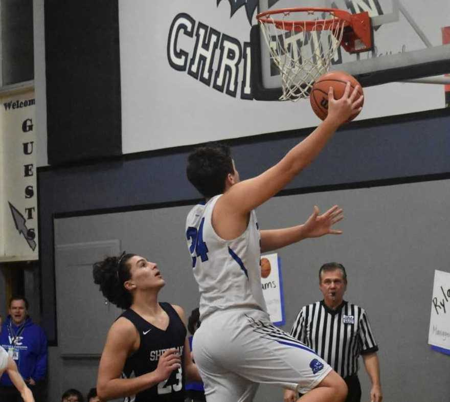 Ethan Halgren goes up for two points in Western Christian's win over Sheridan on Wednesday. (Photo by Jeremy McDonald)