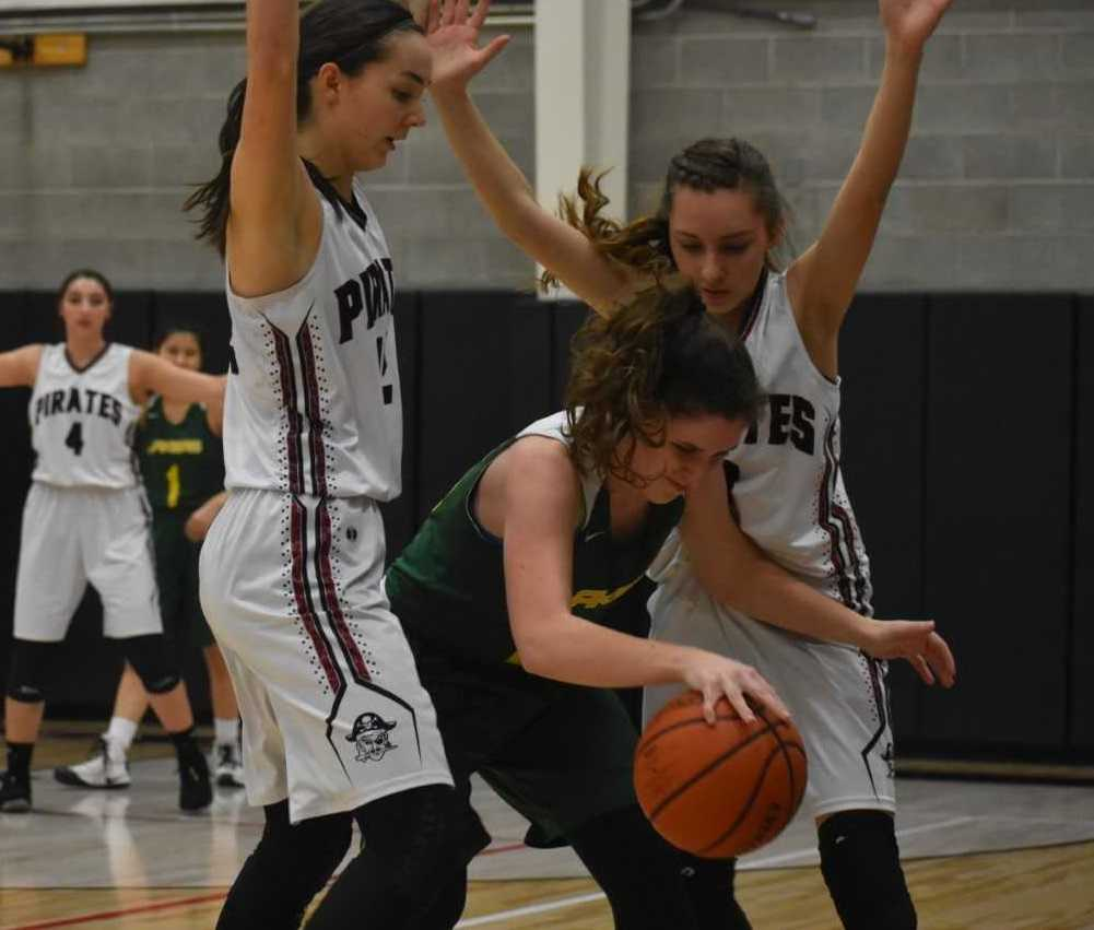 Perrydale's Amity Deters (left) and Sydney Lawrence (right) trap a Triangle Lake player Wednesday. (Photo by Jeremy McDonald)