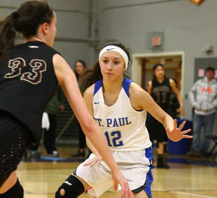 St. Paul's Diana Hernandez (12) guards Damascus Christian's Emily Powers (33). (NW Sports Photography)