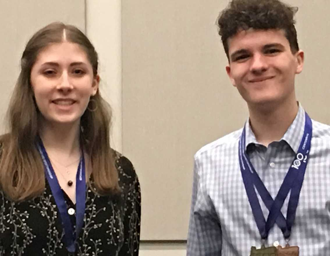 Grant's Zoe Beyler (left) and West Salem's Logan Krause pose with their medals.
