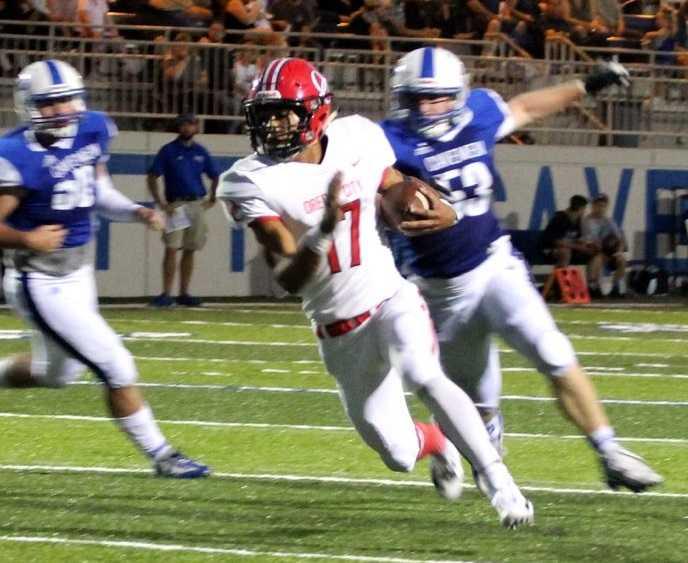 Oregon City's Zakhayas Dennis-Lee scored five touchdowns against Grants Pass.